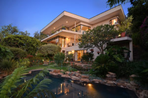 Real Estate -Exterior dusk house and pool in Johannesburg