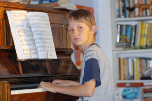 Damian at piano - family photography