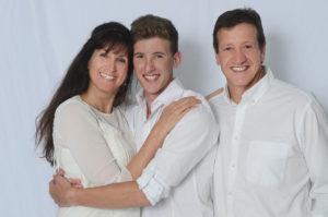 Family against white backdrop