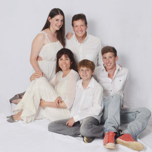 Family in white on studio background
