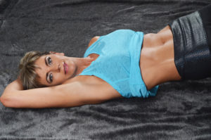 Physical fitness photograhy -woman showing stomach muscles