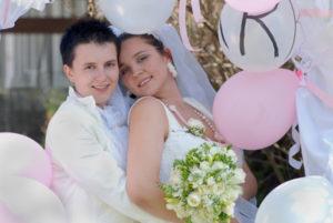 Same sex wedding couple with balloons
