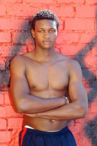 Lander-Johnson-black male model against red wall