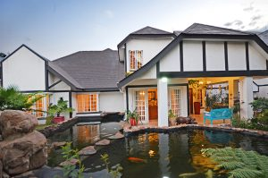 6 Pytchley rd Bryanston -dusk house and fishpond