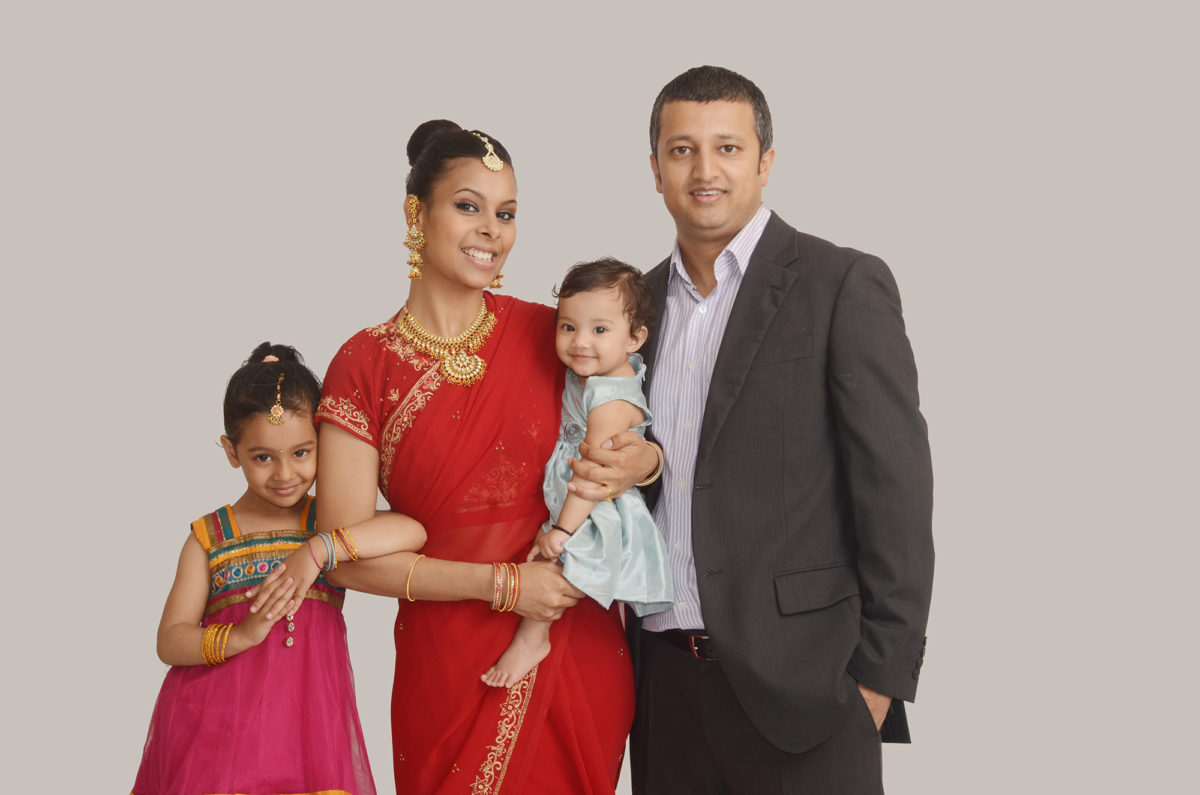 Indian family against white backdrop