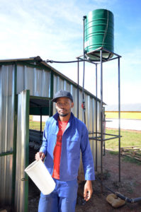 Chicken farmer leaving shed