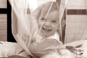 Baby in netting -family photography