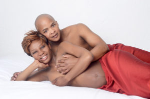 Pregnant couple with red cloth
