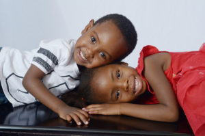 Black brother and sister on table