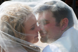 Shae and Grant kiss under veil