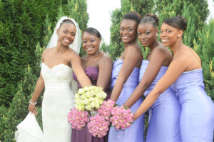 Bride Gisele and bridesmaids holding bouquets together
