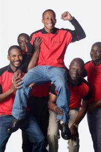 Black colleagues holding man aloft