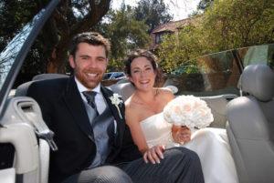 Bride and groom in bridal car
