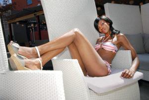 Black female model on white chair
